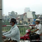 Biking across a bridge in Hanoi.