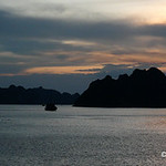 Junks in Ha Long Bay at sunset