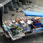 The woman working this vending boat was very camera shy. Also grumpy. I only saw an all-black outfit like this once or twice, and I wonder if she is still connected with Viet Cong or just li ...