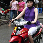 Motorbikes and walking are the way to get around Hanoi, and the women just wear whatever they need for their destination.