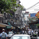 Busy Hanoi street with amazing amount of electrical and phone wiring!