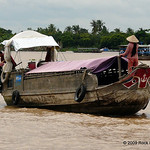 The eyes on the front of these sampans help them see up the river.
