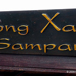 "Song Xanh means literally ""River blue"". The Mekong is most definately brown, so this Sampan may dream of being elsewhere."