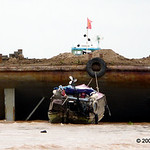 Giant barge makes its way down the river with a payload of dirt.  Construction is a massive industry in Vietnam now that the west has been allowed to freely invest.