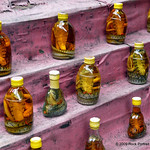 Bottles of snake wine. This is rice wine in which a venomous snake (usually a cobra) is preserved, allowing the venom to dissolve in the liquor. I may try some next time.